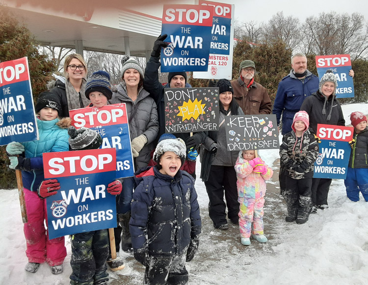 Locked out Teamster Local 120 members and their families picket at gas station supplied by Marathon Oil in St. Paul Park, Minnesota, Jan. 30 in fight against unsafe working conditions.