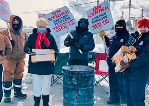 President of Minnesota Nurses Association delivers firewood donation to workers locked out by Marathon Petroleum in St. Paul Park, Minnesota. Strike support is crucial for the union.