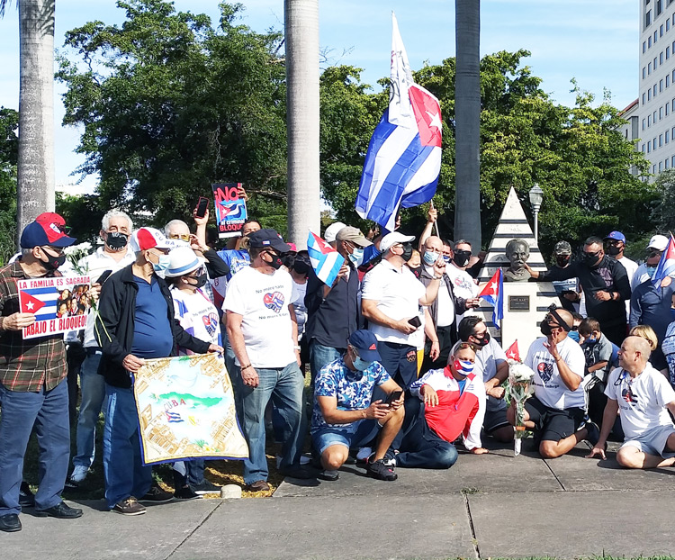 Caravan participants in Miami Jan. 31 protesting U.S. government embargo of Cuba rally at José Martí monument, above. Car caravans occurred in Seattle, Los Angeles and New York as well.