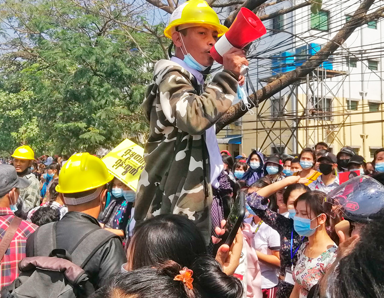 Workers in Yangon's Shwepyithar Industrial Zone protest Feb. 17 against military coup and for better job conditions. Workers, unions are key component of protests against military rule.