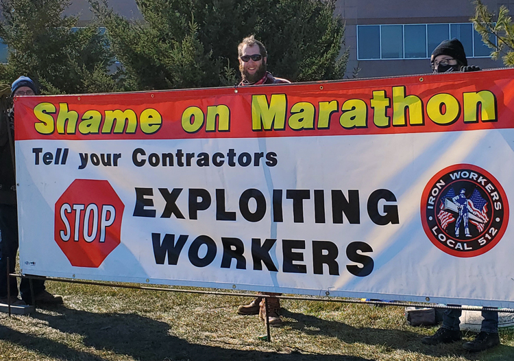 Iron Workers Local 512 members hold banner at union solidarity rally March 6 in support of Teamsters Local 120 oil workers locked out Jan. 22 by Marathon Petroleum in Minnesota.