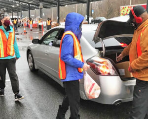 Volunteers give groceries to jobless workers at food bank in Lindenwold, New Jersey. In 15 states last year the percentage of working-age people with jobs fell to the lowest levels ever.