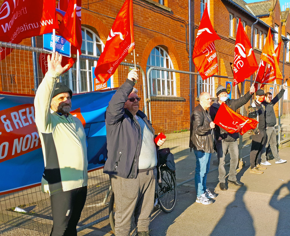 Striking Go North West bus drivers picket in Manchester, England, March 1. Company is trying to bypass workers' Unite union to implement longer work hours, layoffs and benefit cuts.