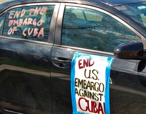 Car plastered with slogans in Chicago carcade the same day.