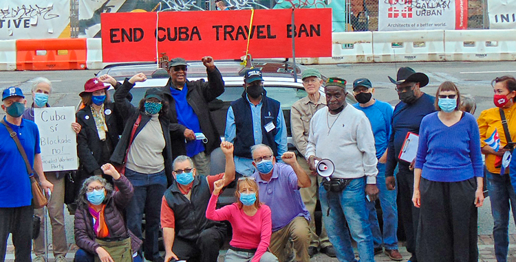 Protesters in Washington, D.C, demand White House end ban on travel to Cuba.