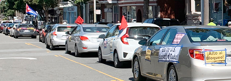 Cars with signs calling for an end to U.S. embargo of Cuba in San Francisco, March 28.