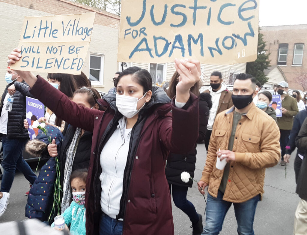 Over 1,000 people march April 18 against Chicago cop shooting of 13-year-old Adam Toledo. Protest began by alley where he was killed and marched through Little Village neighborhood.