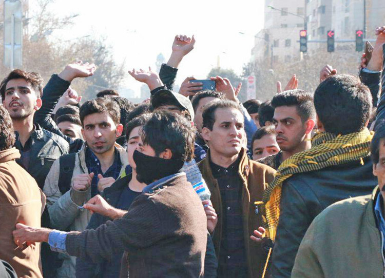 Demonstration in Mashhad, Iran, December 2018, protests government's wars, economic crisis and attacks on political rights. Actions spread to scores of cities across the country.