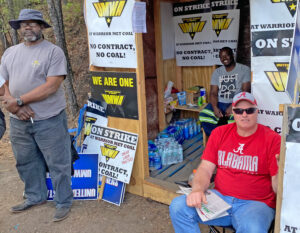 UMWA Local 2397 members Andre Ball, standing on left, and Ronnie Reynolds, seated in the right foreground, staffing the picket line at Warrior Met Coal's No. 7 Mine West Portal.
