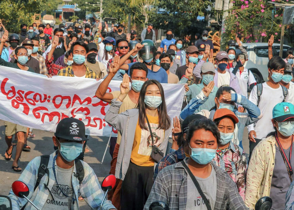 Demonstrators in Mandalay march April 14 demanding end to military rule.