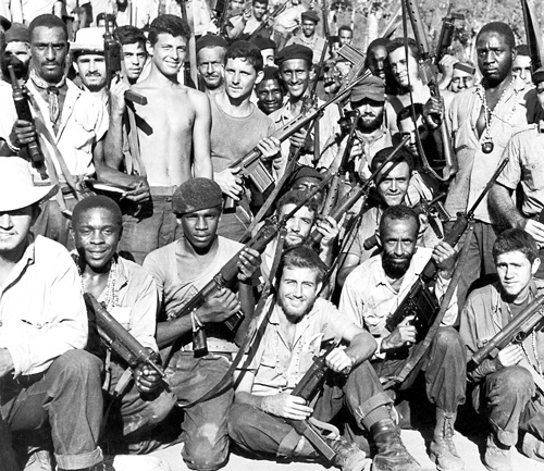 Above, Cuban militia celebrates after defeat of U.S.-organized mercenary invasion at Bay of Pigs in April 1961. Below, one of over 100,000 volunteers in the popular, proletarian yearlong literacy campaign that transformed teachers and students alike, strengthening the revolution.
