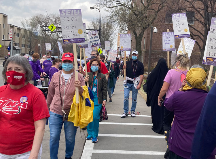Several hundred SEIU members and supporters picket Abbott Northwestern Hospital in Minneapolis April 7 in fight for new contract, more staffing to ensure safety, higher wages.