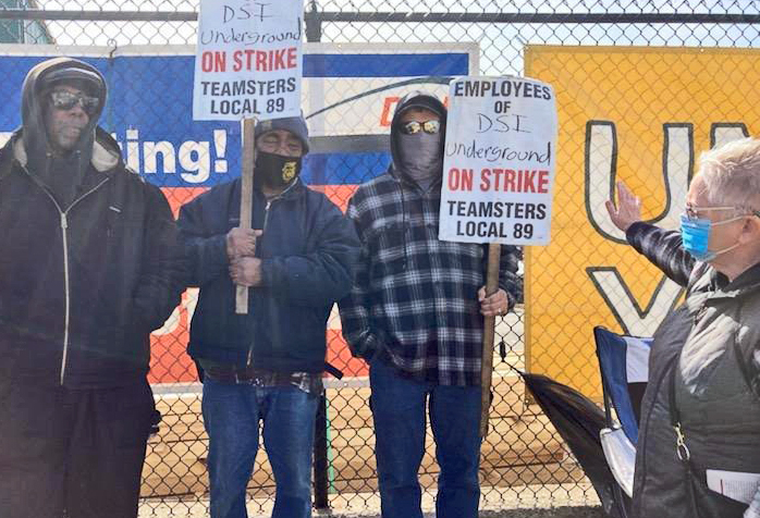 """Teamsters Local 89 members, on strike against DSI Tunneling for a contract since last August, picket in Louisville, Kentucky, March 19. The steel-fabrication workers joined the union in 2019. """"They hired temporary workers and hoped we'd go away. But we're still here, getting support from other workers,"""" Knox Harris, center, told SWP member Jacquie Henderson, right."""