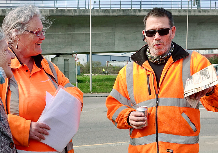 """Natalie Garwood with Billy Spencer, a retired union delegate, at refuse workers' picket in West Thurrock April 21. Garwood, the first woman refuse collector in U.K., has worked there 27 years. """"Each time we're forced to take action, we've come out on top,"""" she said."""