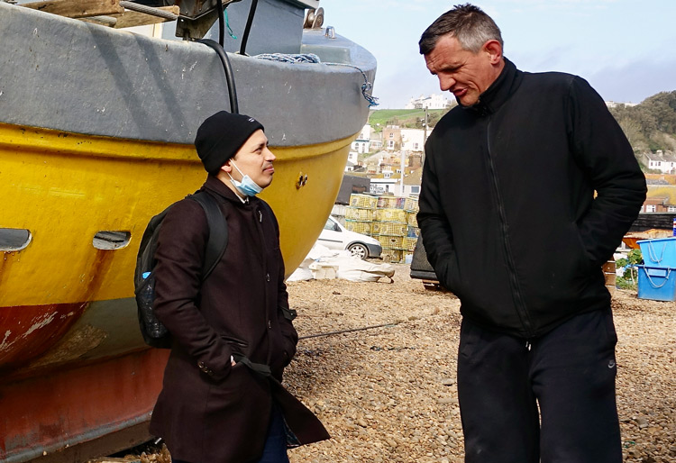 """Andrés Mendoza, left, Communist League candidate for London mayor, talks to Lee Colgan March 12 in Hastings, south of London. Colgan, a small fishing boat crewman, said because of U.K., EU restrictions, he """"can't make a living as a fisherman"""" and has to work a second job."""