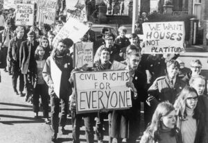 In October 1968, Belfast University students joined Northern Ireland civil rights movement against anti-Catholic discrimination in jobs, housing, education and political representation. In 1969, London sent British troops to repress movement with deadly force.