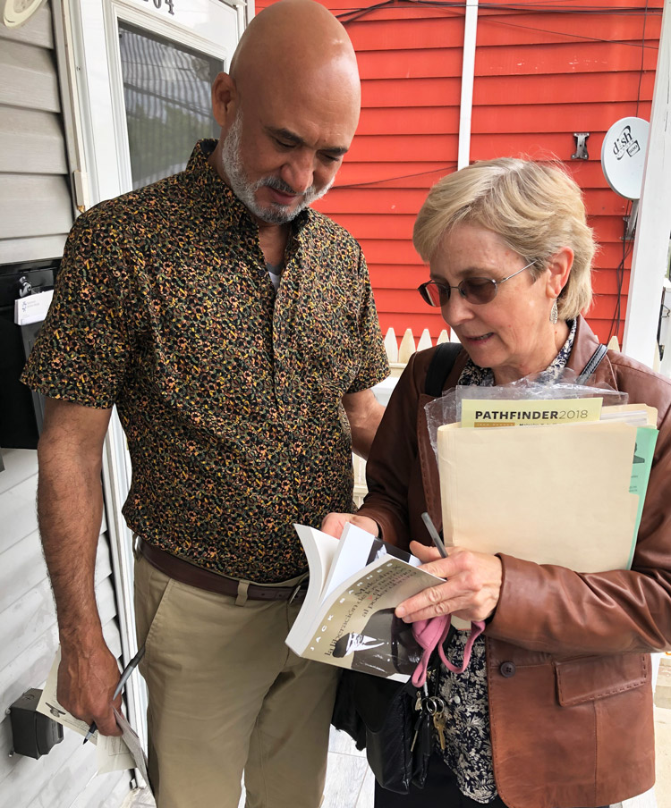 Candace Wagner, SWP candidate for N.J. lieutenant governor, introduces Militant, Malcolm X, Black Liberation, Road to Workers Power to truck driver William Torres in Passaic, who subscribed, signed to put SWP on the ballot.