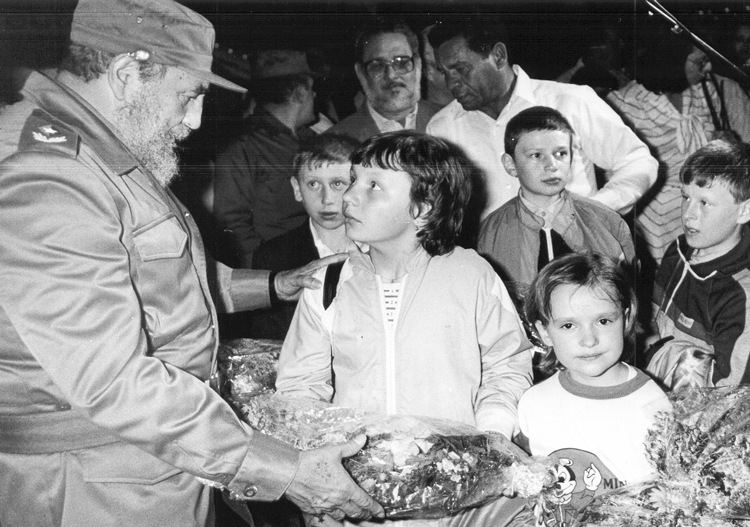 Cuban President Fidel Castro, left, greets children arriving from Ukraine, March 29, 1990. Over 25,000 affected by Chernobyl radiation poisoning, mainly from Ukraine but also Belarus and Russia, received free medical treatment under internationalist program of Cuban Revolution.