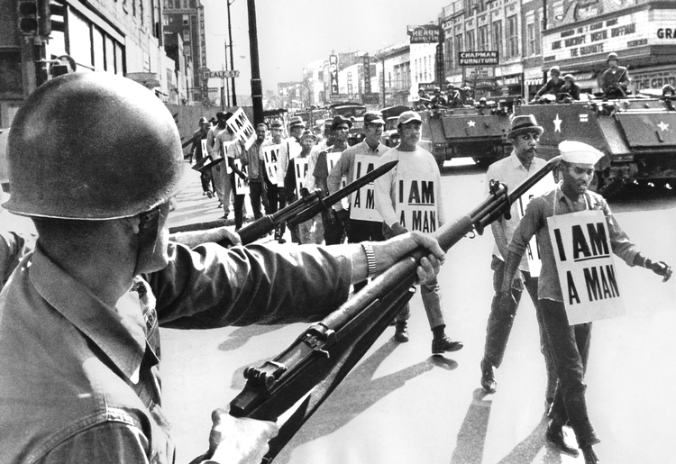 """Striking sanitation workers march in Memphis in 1968, registering courage, discipline and dignity at proletarian heart of battle against Jim Crow segregation. """"That battle remains an example for us today, as the pent-up anger explodes over decades of police brutality and cop shootings,"""" Waters said."""