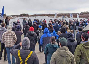 """Striking steelworkers rally May 12 in Port-Cartier, Quebec, against """"final"""" contract demands by ArcelorMittal. Strikers include 2,500 iron ore miners, processing, rail and office workers."""