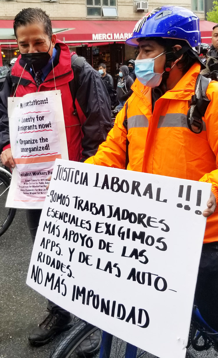 """SWP candidate for mayor of New York, Róger Calero, marches with delivery worker Rogelio Martinez during April 21 """"deliveristas"""" protest."""