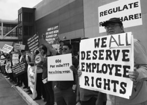 """Uber, Lyft drivers picketed Los Angeles airport May 2019 demanding """"living wages."""""""