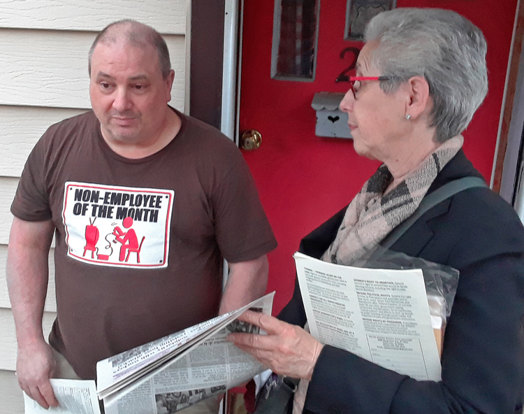 """""""My boss made me employee of the month,"""" Paul Stettler told Joanne Kuniansky, SWP candidate for New Jersey governor, on his doorstep May 6, """"so I had to get this T-shirt."""""""