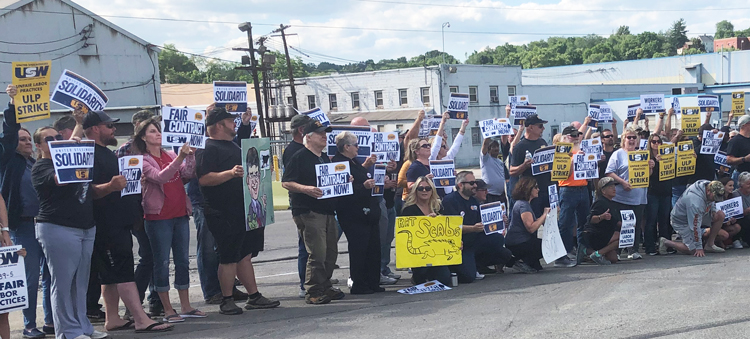 United Steelworkers union members on strike against Allegheny Technologies Inc. and their supporters rally at plant in Washington, Pennsylvania, June 22. Workers are fighting against company attacks on union, cuts in retirement benefits, demand workers pay more for health insurance.