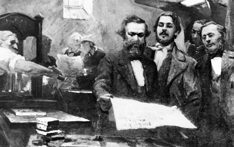 """Karl Marx, holding Neue Rheinische Zeitung with Frederick Engels in 1848 German revolution, helped build Communist League, first modern working-class party. Engels wrote, """"Com-munism is not a doctrine but a movement; it proceeds not from principles but from facts."""""""