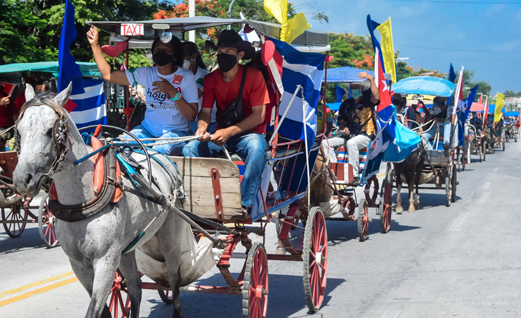 Caravan through Holguín, Cuba. Caravans and rallies protesting U.S. government's economic war against people of Cuba took place around the world June 20, three days before U.N. voted to demand end to Washington's embargo on Cuba.