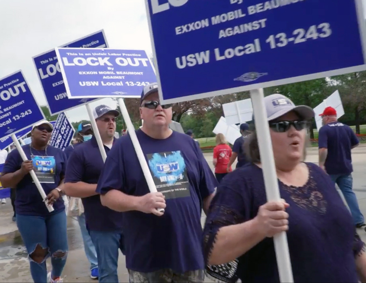 """Steelworkers locked out by ExxonMobil protest outside corporate headquarters in Irving, Texas, May 26. """"The company is trying to bust the union,"""" Local President Darrell Kyle said."""