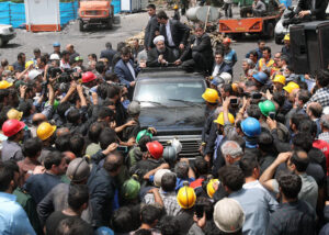 Iran's President Hassan Rouhani, in car, surrounded by protesting coal miners in Azadshahr, Iran, May 2017. His reformist forces have been barred from running in June 18 presidential election. For years workers have fought to end rulers' wars abroad, economic crisis at home.