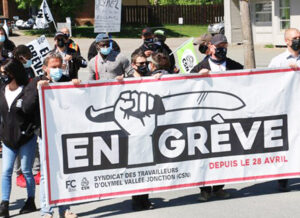 Over 250 striking meatpackers, members of Union of Olymel Workers at Vallee-Jonction in Quebec, marched May 24 against bosses' demands for concessions on health, safety and jobs.