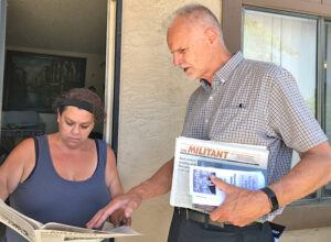 Dennis Richter, SWP candidate for California governor, talks to unemployed home care worker Liliana Garcia in San Ysidro June 11 about amnesty for undocumented workers living in U.S.