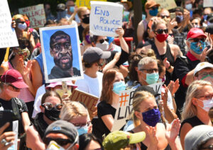 """Mass protest in St. Paul, Minnesota, May 31, 2020, against cop brutality, death of George Floyd. People in working-class neighborhoods where shops were hit by arson and looting, and who face growing anti-social violence, don't support liberals' calls to """"defund,"""" abolish the police."""