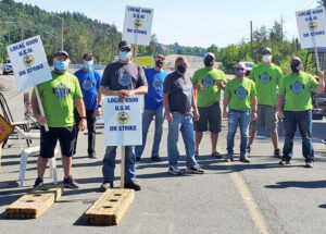 Members of United Steelworkers Local 6500 picket Vale's Coleman Mine June 4 near Sudbury, Ontario. Some 2,400 workers went on strike June 1 at company's mines, mill and smelter.