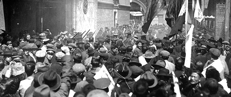 Workers militia marches through parts of Shanghai, part of revolution led by Chinese Communist Party, March 1927. Under orders from Joseph Stalin, CCP leaders instructed members to lay down their arms, paving way for defeat of revolution by capitalist and landlord forces led by Chiang Kai-shek. Stalin tossed aside proletarian internationalist course of Communist International under Bolshevik leader V.I. Lenin.