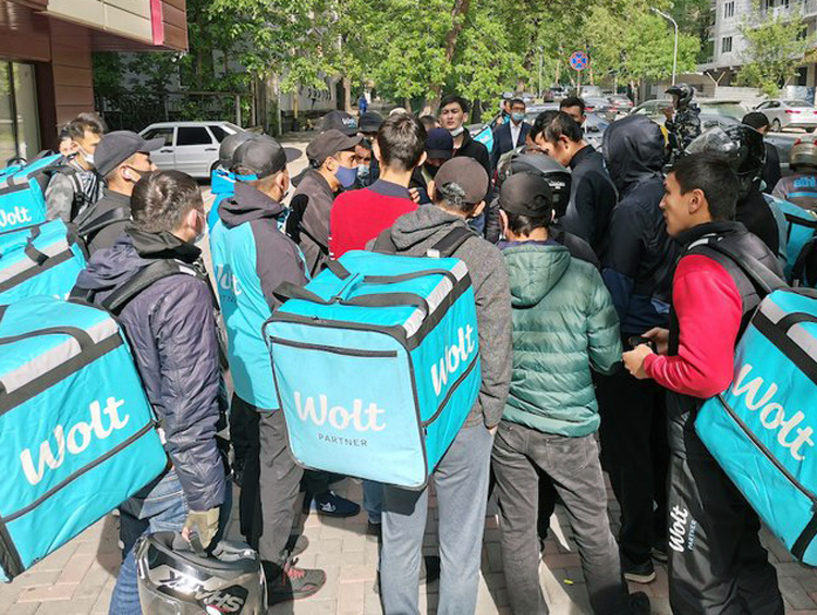 Food delivery workers in Almaty, Kazakhstan, protest working conditions, pay cut and suspensions imposed by Wolt bosses in May. Workers from different app companies acted together.