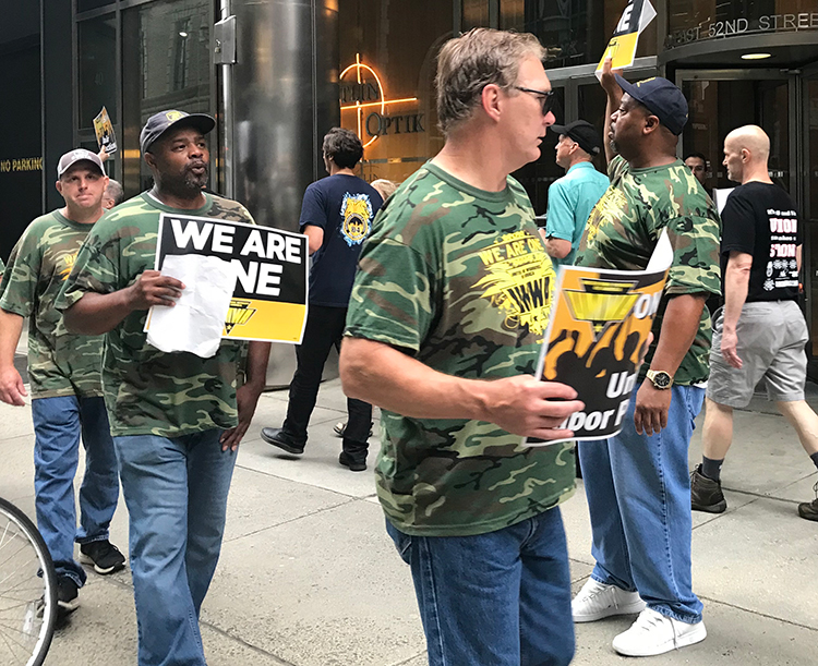 Members of United Mine Workers on strike against Warrior Met Coal in Brookwood, Alabama, and supporters picket one of company's owners, BlackRock hedge fund, in New York June 22.