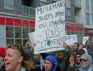 Protest against Law 21 in Montreal, 2019, that bans public sector workers from wearing religious symbols at work. New Bill 96 introduced in National Assembly in May would limit access to English in schools, government matters, at a time French-English bilingualism has increased.