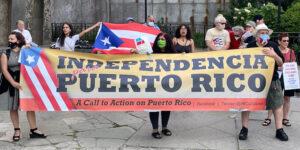"""Participantes en audiencia sobre descolonización de Puerto Rico en la ONU el 18 de junio se unen a acto convocado por ProLibertad. El lema fue, """"Solidaridad con Puerto Rico y Cuba: Dos alas de un mismo pájaro""""."""