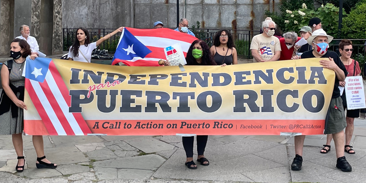 """Participants from June 18 UN hearing on decolonization of Puerto Rico join rally that day called by ProLibertad Freedom Campaign. Theme of protest was, """"Solidarity with Puerto Rico and Cuba: Two Wings of One Bird."""""""