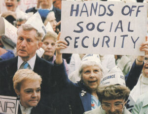 Protest in Philadelphia by retired workers against Social Security cuts in late 1980s. Rich bondholders demand government cut social wage, not profitable interest payments on government bonds, to cover rising state debts. This attack hits what working people see as a social right.