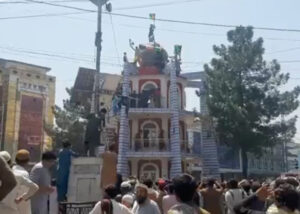 Afghan national flag raised again in main square protest in Jalalabad Aug. 18 after its removal by Taliban. Three people were reported killed, 12 wounded as Taliban soldiers fired on crowd.