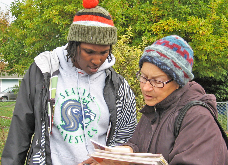 Cecelia Moriarity showing Militant, books by Socialist Workers Party leaders, other revolutionaries to Darralita Taylor in Seattle in 2013. She explained Militant was uncompromising.