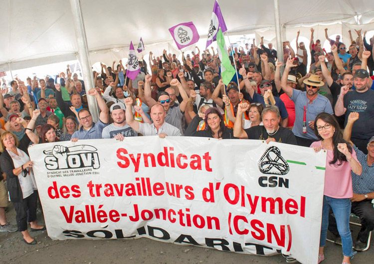 Members of CSN union on strike against Olymel hog slaughterhouse in Vallee-Jonction, Quebec, meet, discuss and vote down arbitrator's proposal Aug. 3. Company demanded union officials recommend the arbitrator's offer to members. They refused and workers rejected it.
