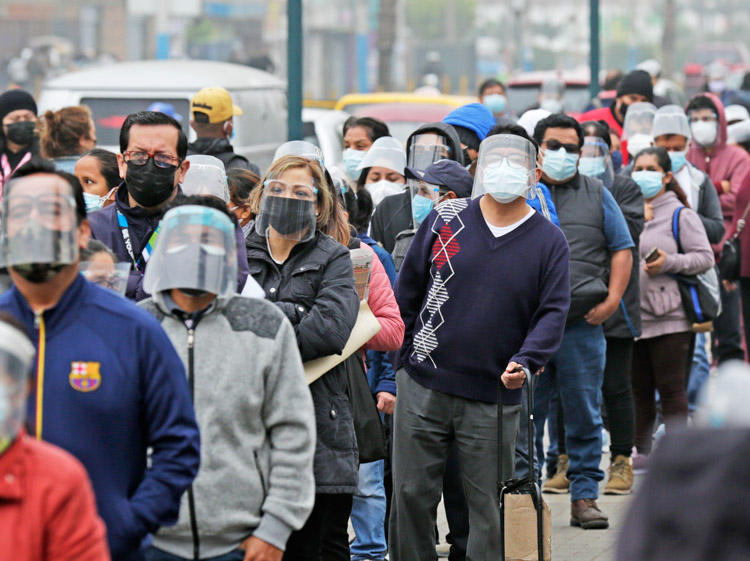 Hundreds wait in long lines attempting to get a COVID-19 vaccine in San Martín de Porres district in Lima, Peru, July 4. Peru has the world's worst per capita death toll from the virus.
