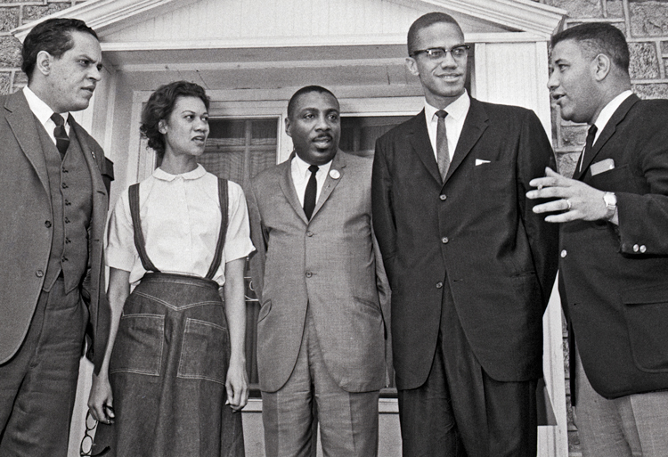 Meeting in Chester, Pennsylvania, hosted by Freedom Now Committee, March 14, 1964, to form Black rights group ACT. From left, Lawrence Landry, Chicago school boycott leader; Gloria Richardson; comedian Dick Gregory; Malcolm X; and Stanley Branche, committee chair.