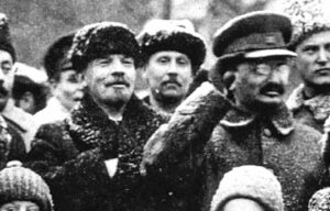V.I. Lenin, above left, leader of Russian Revolution, pictured alongside Leon Trotsky, commander of Soviet Red Army, Nov. 7, 1919. Inset, Joseph Stalin ordered Trotsky and others crudely airbrushed out of history as his bureaucratic machine prepared purge of those revolutionary leaders fighting for Lenin's proletarian internationalist course.