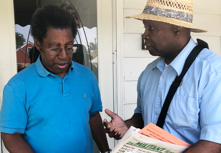 Socialist Workers Party campaigner Leroy Watson, right, discusses historic advances in fight against racism, including on strike picket lines, with Ben Allen, in Bellwood, Chicago, Aug. 1.